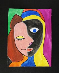 Create a #Picasso style portrait using water colour and outline it with permanent markers. It's a project that kids will enjoy!