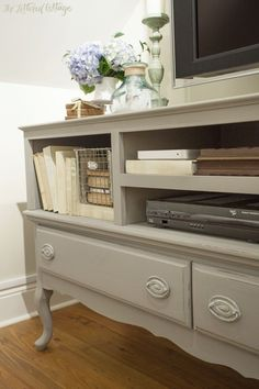 Pine Floor | Khaki Sofa | Wool Skein Paint | Closet Makeover Wool Skein by Sherwin-Williams on walls and the credenza-turned-TV stand is painted with Annie Sloan's French Linen chalk paint.