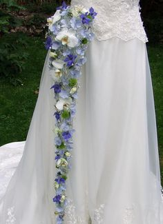 Looking for something blue? Choose this trailing cascade wedding bouquet with white phalaenopsis orchids, blue hydrangea and blue delphinium, with Swarovski crystals and beads   www.blackbaccara.co.uk