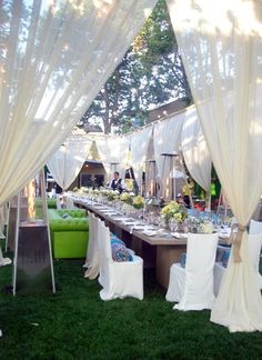 Outdoor family style reception- pipe and drape. I like this idea to keep it private feeling. Can be done very cheap with muslin and 40% off coupon at Joannes.