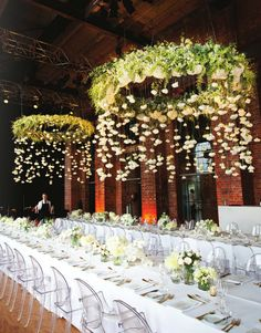 House of Hydrangeas: Five Things    Hanging flower halos over banquet tables...   Amazing!     maybe using hula hoops / foam noodles to make the hanging wreaths, you could also add icicle lights dangling from them!