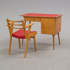 A 1950s writing desk and chair.