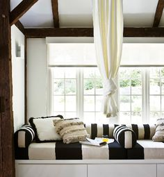 Small Space, Big Design: Nooks & Niches  The design firm From the Desk of Lola added graphic striped fabric and exotic throw pillows to this corner window space, which lends a glamorous note to the relaxing, light-filled room.
