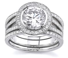 18K White Gold Sareen Split Shank Matching Bridal Set (1.04ctw) Item # 12198R4   This ring is a matching set and is makes a statement of elegance and power. Featuring a split-shank set with two mounted bezel brilliant diamond rings below the center stone, and two eternity bands that harmonize shimmer and shine!   http://www.novori.com/sareen-diamond-engagement-rings-12198R4-p.html#