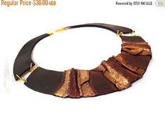 40% OFF Venta geométrica cuero colgante elegante negro y oro