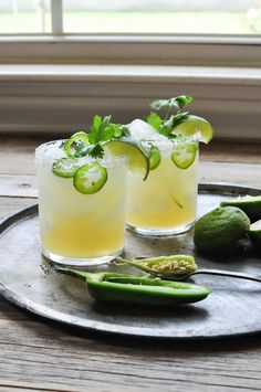 Fresh Lime & Jalapeno Margarita is part of food_drink - This fresh lime & jalapeno margarita is simply made with lime juice, silver tequila, honey, and some jalapeno + cilantro for a delicious Paleo twist Cocktails Champagne, Summer Cocktails, Cocktail Drinks, Fun Drinks, Cocktail Recipes, Beverages, Lime Drinks, Sweet Cocktails, Jalapeno Margarita