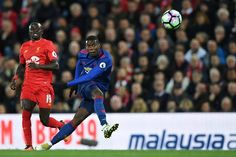 Manchester United's French midfielder Paul Pogba takes a shot which goes wide during the English Premier League football match between Liverpool and...