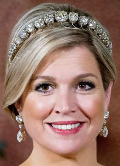 Queen Maxima wearing a Diamond Bandeau. Created for Queen Juliana using large diamonds her grandmother, Queen Emma, received as a wedding gift. Initially, 34 of these giant gems were set in a necklace. The royal family may have had the necklace altered into a shorter form before the diamonds were set into this tiara with a simple platinum frame.