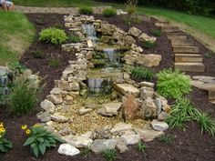 Tiered Pondless Waterfall, Limestone Boulders, Retaining Wall, Dyed Brown Mulch.