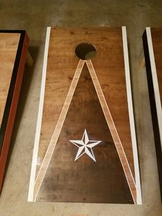 My cornhole board I made. I painted and stained and used a decal for the star. Frog tape is my friend. Painted Corn Hole Boards, Kitchen Island Storage, Xeriscaping, Cornhole Boards, Crafty Projects, Backyard Ideas, Creative Ideas, Camper, Decal