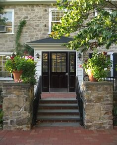 Is a black front door bad luck?  I think its lovely!
