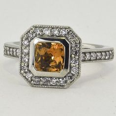 Platinum Sapphire Fancy Bezel Halo Diamond Ring with Side Stones. Set with a 0.87ct 5.5mm Radiant Yellow Sri Lanka Sapphire. #BrilliantEarth