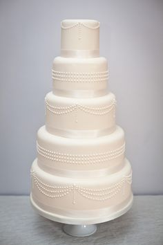 Classic hand piped ivory wedding cake By S K Cakes www.s-k-cakes.co.uk