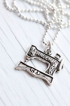 Singer pendant for a crafter