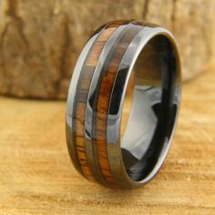 By far one of the most unique mens wedding band. The ring is called The Vintage Barrel Ring. Hence, that is where the design came from for this amazing wood wedding band. This makes a perfect mens wedding band. It is crafted out of black high tech ceramic Wooden Rings Craft, Wood Rings, Unique Mens Rings, Rings For Men, Stylish Rings, Barrel Rings, Black Gold Jewelry, Jade Jewelry, Emerald Jewelry