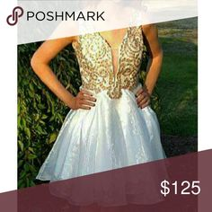 """Homecoming Dress Beautiful, elegant, white and gold dress, perfect for Homecoming!  Gorgeous detailing, tulle and silky lining underneath, with chiffon overlay.  Worn once. Minor spots on overlay, reflected in lower price. Accepting offers.  Bust 32"""" Waist 27"""" Length 35"""" Dresses Prom"""