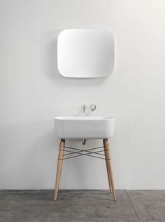Ray Ceramic Washbasin by Michael Hilgers is a minimal, retro-look affair, with a ceramic basin set atop wooden legs braced with varnished steel wires that can serve as towel holder