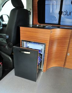Teak Interior Finish for Campervan Conversions with pull out fridge.