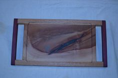 Madrone slab w/ oak edges and purple heartwood handles, with inlayed turqouise and tempered glass, for hot items and to avoid stains.