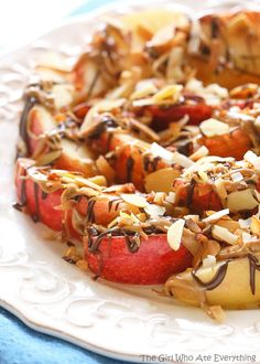 Chocolate Peanut Butter Apples with Coconut and Almonds - believe it or not this is healthy! Only 156 calories...