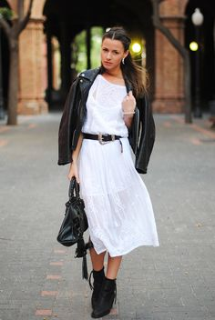Love the black leather jacket with the gauzy dress. It's Ying and Yang. Also chic are the heavy black shoes with the gauzy dress. Biddy Craft