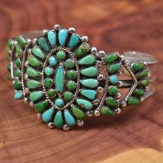 "Vintage Sterling Silver and Turquoise Petit Point Cuff. Note how some stones have ""greened up"" from exposure to body oils. Typical of natural Sleeping Beauty turquoise favored by Zuni artists."
