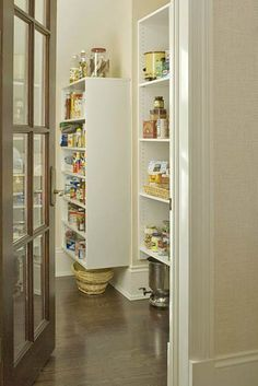 Pantry with Adjustable Shelves-  In addition to a formal, traditional-style butler's pantry, this kitchen includes a more casual and contemporary walk-in pantry. The hardworking space is equipped with adjustable-height storage shelves for greater flexibility. Large items can be tucked above and below the shelves.