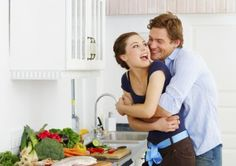 Cooking in the kitchen and get a sneak attack hug! :)
