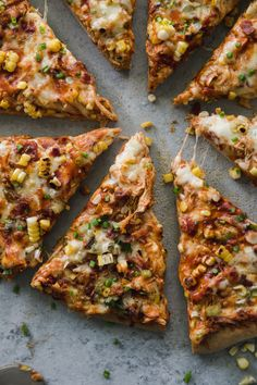 This BBQ Chicken Pizza with Grilled Corn and Scallions is the perfect pizza for summer! Perfect for using up leftover pulled chicken or even pulled pork from a cookout! It's topped with grilled corn, bacon, pepperjack cheese, and grilled scallions too! Grilling the scallions adds the best flavor to this pizza, and all that's missing is an ice cold beer! #pizza #grillingrecipe #summer