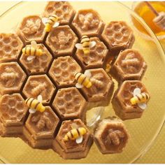 Photo and recipe: Nordic Ware Our unique Honeycomb Cake Pan creates a beautiful golden cake with bee and honeycomb designs. Make a Lemon Honey honeycomb-shaped cake with pull-apart sections for easy sharing - perfect for a spring tea party! Cupcakes, Cupcake Cakes, Bundt Cakes, Chocolate Transfer Sheets, Honeycomb Cake, Golden Cake, Fondant, Pull Apart Cake, Honey Cake