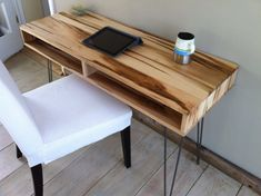 Mid century modern desk featuring wormy maple top and hairpin legs.