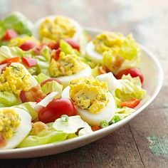 Garlic and hot pepper sauce add heat to the deviled eggs that top off this simple salad loaded with vegetables.