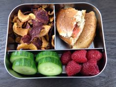 School lunch: bagel with lox, sweet potato and beet chips, cucumber slices, and raspberries in the LunchBots Trio