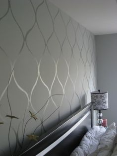 Flat paint, then glossy enamel in the same color create a subtle wallpaper-like look. LOVE this idea!!