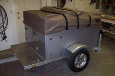 Here is a customers Explorer Box from a while back; this one sports an aluminum frame, fiberglass reinforced trailer box and an automotive grade paint job, for additional pictures and info visit, http://compactcampingconcepts.wordpress.com/2010/12/17/featured-customer-explorer-box-build/