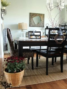 Each end of this dining room table is marked with a woven rattan chair, found at TJ Maxx.