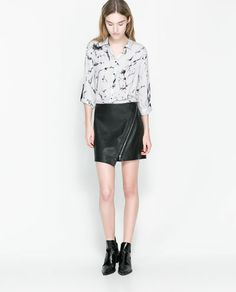 Image 1 of FAUX LEATHER SKIRT WITH ZIP from Zara