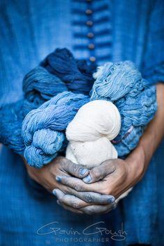 A man holding balls of yarn dyed with indigo, Indigo Dyeing Factory, Sakhon Nokhon, Thailand