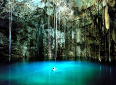 Dzitnup Cenote, Valladolid, Mexico, Yucatan, Mexico — by Earl Baron. Stalagmites and stalactites fill this cave/underwater swimming hole where you can jump in the cool water and go for a...