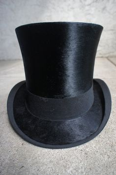 The taller and shinier a top hat, the more expensive and well made it is. If it's short and stumpy and not shiny at all, you know it's a cheap one.