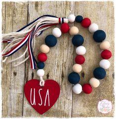 Wood Bead Garland, Beaded Garland, Fabric Garland, Garlands, Spool Crafts, Yarn Crafts, Bead Crafts, Patriotic Crafts, Patriotic Decorations