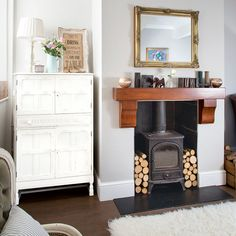 After living room decorating ideas? Check out this cosy living room with a woodburning stove