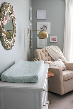 """I wanted something slightly girly with not too much pink for my baby girl's room. This room used to be our """"office"""" and the walls were already painted this color. I worked around the wall color to avoid painting again and it turned out just as I had hoped. This room is pretty small and her closet is on the tiny side as well. We knew we would need some additional storage, so we decided to add the floating shelves. The baskets store things like bibs, socks, shoes and extra bl..."""