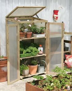 This greenhouse is a clever solution to grow veggies in cooler climates, especially for small gardens. | The Micro Gardener