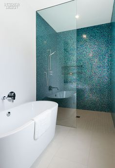 A Toronto home's shower stall from our simply amazing kitchen and bath roundup is clad in a scintillating mosaic of aquamarine glass tile sprinkled with magenta. Photography by Steve Tsai. Bathroom Renos, Bathroom Interior, Small Bathroom, Bathroom Ideas, Mosaic Bathroom, Bathroom Designs, Mosaic Shower Tile, Kitchen Mosaic Tiles, Bathroom Feature Wall Tile