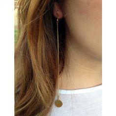 Long drop gold medallion earrings