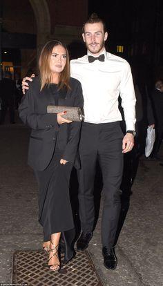 Date night: Footballer Gareth Bale put his arm around his beautiful girlfriend Emma Rhys-J...