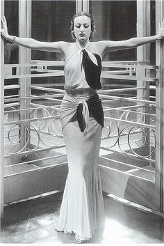 Joan Crawford wears a streamlined dress as Letty Lynton in 1932, designed by Adrian. It demonstrates the fashion for classical drapery with its bias-cutting, draping and wrap details.""