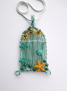 Seashore Fairy Door pendant. Original wire fairy door jewellery, with starfish and seaweed. www.etsy.com/uk/shop/LouiseGoodchild