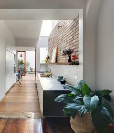 love the natural light from the subtle skylight above and the neat placing of the kitchen